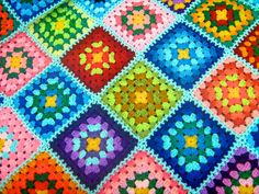 granny squares-many colors, but all yellow centers-like the look of the way they are joined.