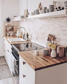 A white or black stove top cover in this quaint kitchen would add more countersp. A white or black stove top cover in this quaint kitchen would add more counterspace. Click the photo to find one cus Home Decor Kitchen, New Kitchen, Home Kitchens, Kitchen Dining, Bohemian Kitchen Decor, Small Galley Kitchens, Open Shelf Kitchen, Hippie Kitchen, Cute Kitchen