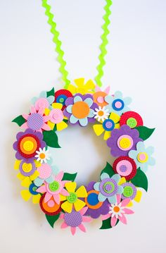 This colorful DIY flower wreath made from a felt flower craft kit will bring an instant dose of spring to your home. An easy craft that's perfect for a