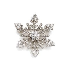 "Van Cleef & Arpels brooch ""Snowflake"" In 18k white gold (750), with radiating decoration set with diamonds, those in the center and larger ends Year 2000"