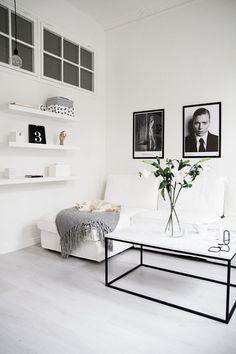 With bleached wood floors in the living room & a white backdrop throughout, this apartment in Stockholm has such a beautiful style … cool lighting & artworks, minimal furnishings & a few flowers here