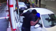 Watch: Four armed men hijack a woman at a parking garage [video]
