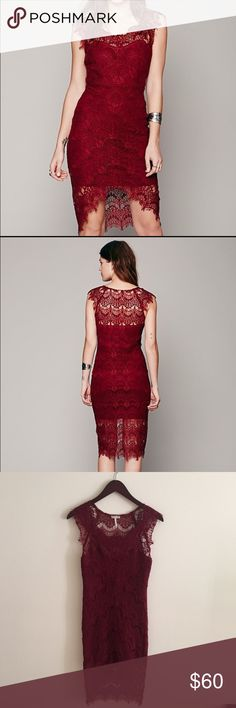 Free People • Peekaboo Lace Dress Red lace dress by Free People.  Cotton slip under a lace high-low with cap sleeves.  No pulls or imperfections in the lace.  Beautiful, delicate and only worn once!  • Shell: 55% nylon, 45% cotton.  Slip: 95% cotton, 5% spandex • No trades ✖️ • All offers considered ✔️ • Bundling encouraged ⭐️ Free People Dresses