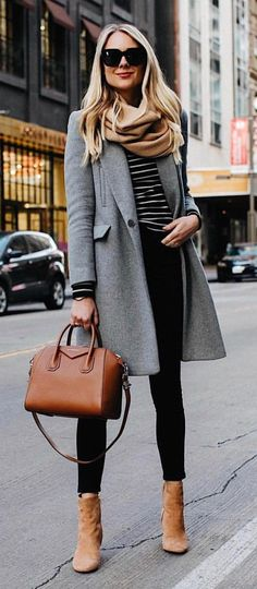 #spring #outfits woman in black pants standing on asphalt road during daytime. Pic by @fashion.voyage