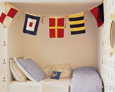 Nautical-inspired pieces accent the boys' room at actress Jennifer Creel's Manhattan home.   - ELLEDecor.com