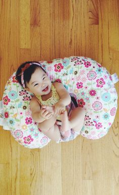 Boppy Slipcovered Pillow -This versatile pillow lifts baby to a more ergonomic position for comfortable feedings, then transitions to the perfect spot for propping, tummy time and learning to sit.