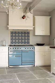 Blue Falcon oven & range, tile backsplash, updates classic white kitchen