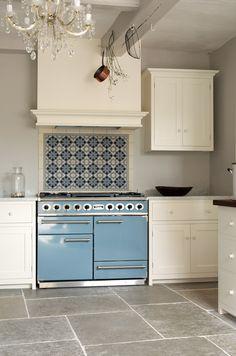 Blue Falcon oven & range, tile backsplash, updates classic white kitchen