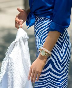 cobalt blue and white zebra print pencil skirt, cobalt blue silk tie front blouse with gold buttons, white mules, + white cropped tweed blazer {@nordstrom}