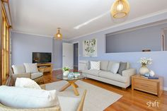 Blue walls, timber floor, neutral sofa in this  coastal family home.  Property Styling. #styledbyshift