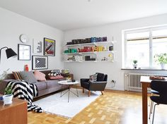 Furniture Adorable Scandinavian Living Room Furniture Ideas: Beautiful Living Room With White Wall Color Wooden Wall Shelves Units On Corner Abstract Wall Painting Small Circular Table Parquet Floor With White Rug
