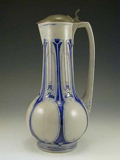 A ceramic flagon with pewter lid. The flagon is decorated with typical secessionist Art Nouveau designs, Austria, c.1905