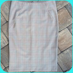 EXPRESS DESIGN STUDIO SKIRT Beautiful plaid, aqua, cream, brown and rust, light weight Summer skirt, perfect the office or a sophisticated lunch outing, polyester, rayon spandex blend, double kick pleat, hidden back zip. Express Skirts