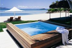Hayman Island Resort - Guests of Hayman are met at the Great Barrier Reef Airport and whisked to the island by yacht, seaplane, or helicopter. Coral-fringed beaches and cascading pools accentuate the secluded style of this private-island resort in the Whitsunday Islands.
