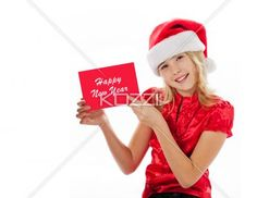smiling girl with a new year greeting card. - Smiling girl with a new year greeting card looking at camera against white background, Model: Shania Chapman - Agent is Breann at MMG. breann@nymmg.com