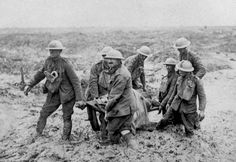 A stretcher bearer patrol painfully makes its way through knee-deep mud near Bol Singhe during the British advance in Flanders, on August 20, 1917