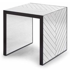 Redefine contemporary style with the Antique Mirror Chevron End Table from Regina Andrew Design. With an artist's eye, their assortment skillfully mixes modern with rustic, elegant with casual, romantic with relaxed. They have an eclectic vision that resonates with natural style.
