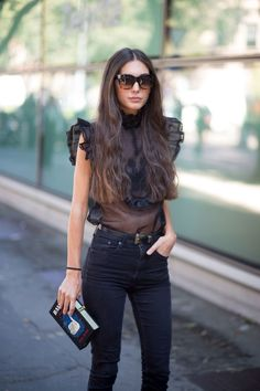 A+sheer+black+top+and+skinny+black+jeans+are+perfect+on+Diletta+Bonaiuti.     - HarpersBAZAAR.com