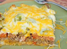 John Wayne Casserole Recipe. This is pretty good, but if we make it again, I would mix the ingredients together so that it's more consistent (other than the final layer of cheese and the biscuit mix), add more vegetables and cheese, and add another packet of taco seasoning.  Maybe serve with salsa also. We also diced everything.