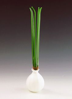 """Spring Onion""  Art Glass Perfume Bottle  Created by Garrett Keisling  Spring Onion perfume bottle made from white and green colored glasses is mouth-blown and hand sculpted at the torch. Fun and functional, the stopper/dropper is hand ground or a tight fit."