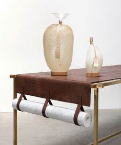 Cool way to store craft paper on a coloring table. Could use reclaimed leather on the mission desk...