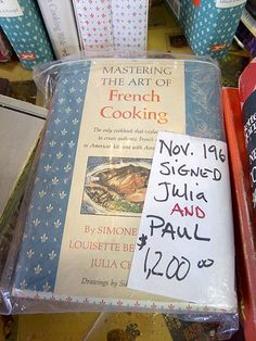 A very rare find. Signed by both Julia Child and her husband Paul.