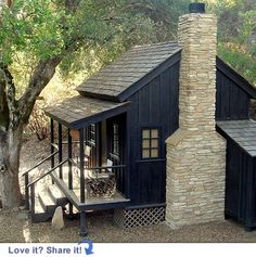 love the dark exterior with the pale stacked stone fireplace