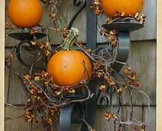 cute idea for halloween decoration if you already have a black wall sconce/candelabra - just replace candles with mini pumpkins.