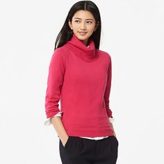 This elegant knit turtleneck features the signature soft, warm comfort and smooth texture of 100% luxurious cashmere. The simple solid color is accented by a varied knit pattern along the sides. The wide ribbed turtleneck adds volume to your look, plus it keeps your neck nice and warm.