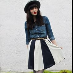 Perfect hair. Perfect hat. Perfect skirt.