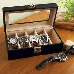 Velvet-lined watch box stores and protects five watches.