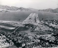 In Transition The new Kai Tak runway under construction. Kai Tak Airport, Argyle Street, Old Steam Train, China Hong Kong, Aerial View, Best Hotels, Monument Valley, Aviation, Landscape