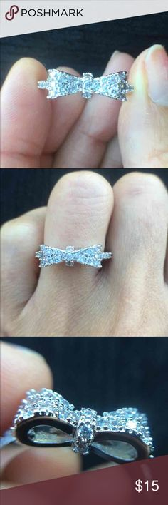 Bow Platinum Plated Engagement Ring - 100% Brand New - Trendy Style, Bowknot shape - Real Platinum Plated Micro Pave Setting Clear Classic Ring with Cubic Zirconia (CZ) Stones - Perfect for engagement,wedding,Promise Ring, anniversaries, Birthdays  - Ring comes in  black velvet jewelry pouch. Jewelry Rings