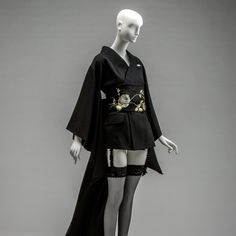 KCI Autumn/Winter This sexy, micro-mini attire uses an orthodox black wool double-breasted jacket as a base. belt of acetate satin covered by silk lace with floral embroidery. Digital Archives, Rhyme And Reason, Double Breasted Jacket, John Galliano, Wool Dress, Draping, Black Wool, Floral Embroidery, 1990s