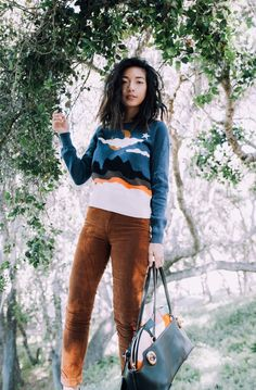 Stephanie Liu of Honey & Silk wearing Coach 1941 Instarsia Sweater and Patchwork Satchel, 7 For All Mankind Corduroys, and Gucci Fringed Heels.