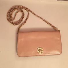Tory burch bag Beautiful rose gold pink bag. Can wear it as a cross body bag or clutch. In great condition only used a few times. Comes with new dust bag. Tory Burch Bags