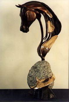 : http://www.willemvanbeelen.com/bronze-granite-sculpture/