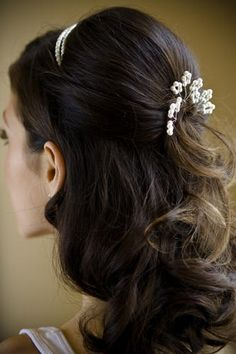 Wedding hair idea: Half up, half down, a clip in back and a tiara.