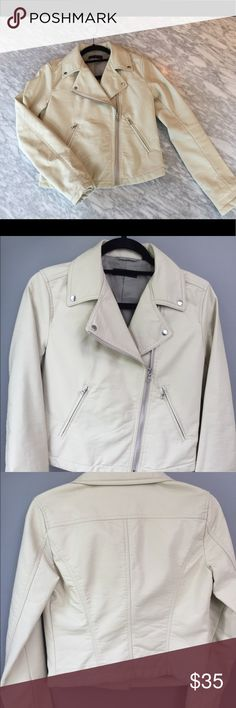Vegan Leather Buttercream Jacket by UniQlo. Vegan (faux) leather buttercream biker style jacket with working zippers.  Soft with great lining and button detailing.  Size small and fits true. Worn only a few times. Some wear on jacket collar (not cracked just distressed a bit from hanger).  Smoke free and please 🚫no trades! Uniqlo Jackets & Coats Utility Jackets