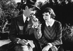 """""""It Happened One Night"""" Clark Gable & Claudette Colbert 1934. Landmark comedy: in one scene Gable removes his shirt and didn't have an undershirt on (gasp!). Sales of men's undershirts subsequently tanked, really! And the carrot he's munching in this scene inspired Bugs Bunny's trademark. This is must-see comedy!"""