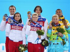 (L-R) Silver medalists Ksenia Stolbova and Fedor Klimov of Russia, gold medalists Tatiana Volosozhar and Maxim Trankov of Russia, bronze med...