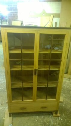 Walnut and Beech display cabinet with draw