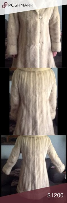 Vanilla vintage knee length full skin mink coat. Knee length vanilla colored full skin mink coat.  Can be used with a belt, does not come with a belt.  Excellent condition.  Does have a name sewn inside.  Can be removed and replaced. Beautiful rhinestones enhance the buttons. Jackets & Coats