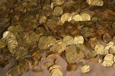 Massive Trove of Gold Coins Unearthed off Israel's Coast -- Nearly 2,000 gold coins were discovered off the coast of the ancient city of Caesarea, Israel. The gold coins are about 1,000 years old, and were minted by the Fatimid Caliphate, which ruled much of North Africa at the time.