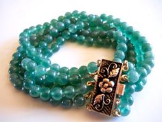 Offering a cashmere green onyx bracelet in sterling silver with 5-beaded strands in vintage:  A stunning estate find of genuine cashmere green onyx beaded bracelet with a s...