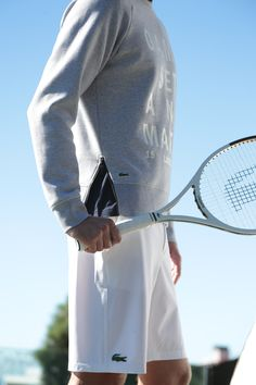 Tennis court must-have: the comfortable Grey sweater paired with the White LT12 tennis racket by Lacoste. #TennisPlanet www.tennisplanet.com