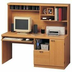 """Computer Workcenter - Soho - O'Sullivan Office Furniture - 10440 by Creative Marketing Group. $309.00. Computer Desk with hutch with lots of worksurface and built in storage. 10440 Features: Large file drawer accepts letter files Sturdy pull out keyboard shelf Hutch with dedicated cd storage Hidden CPU compartment Storage hutch Assembly required Finish: Norwegian Alder Dimensions: 59.375""""(W) x 24.25""""(D) x 56.125""""(H)"""