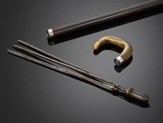 Geometer's Cane - This remarkably rare walking stick doubles as a practical tool for the professional geometer. A tug on the handle of this rare cane reveals a tripod hidden within the shaft, on which the bullet-shaped ferrule is placed for sighting.