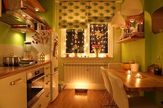 Cozy kitchen with twinkle lights in the windows.