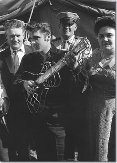 Sept 26, 1956 -  Elvis Presley Day is proclaimed in Tupelo, Mississippi. Elvis' parents join him as he returns to the town of his birth as a big star. He performs two shows at the Mississippi-Alabama Fair and Dairy Show, the same fair at which he had performed at age 10. This time there are 100 National Guardsmen surrounding the stage to control the crowds of excited fans. 14 year old Wynette Pugh (Tammy Wynette) is in the front row.